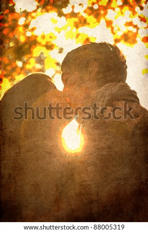 Couple kissing in the park at sunset. Photo in old image color style. - stock photo