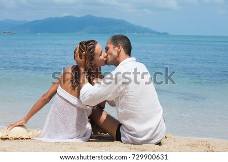 Couple kissing on a beautiful beach