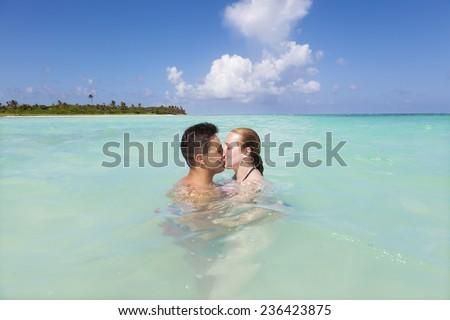 Couple kissing on a idyllic beach at Riviera Maya, Mexico - stock photo