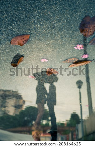 couple kissing, water reflection view - stock photo