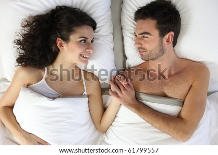 Couple laid in a bed