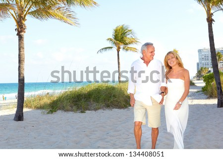 Couple laughing at the beach enjoying themselves. - stock photo