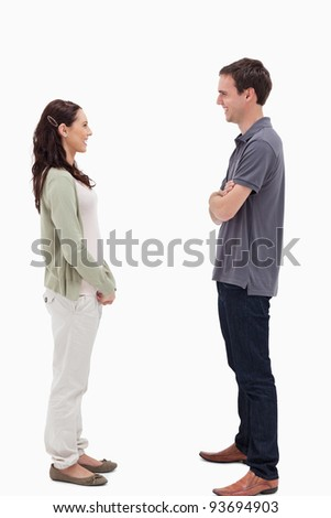 Couple laughing face to face against white background