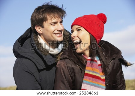 Couple Laughing In The Park Together - stock photo