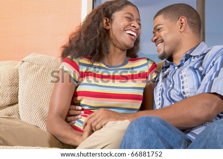 Couple laughing together - stock photo