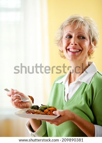 Couple: Laughing Woman Eats Healthy Dinner - stock photo