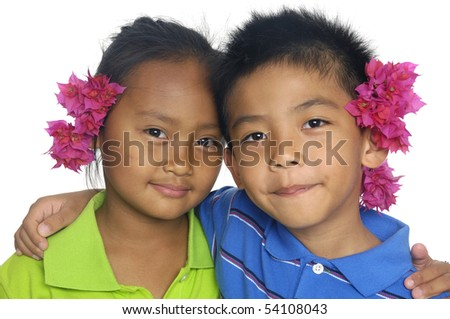 Couple little kid with red flower - stock photo