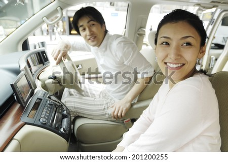 Couple look out from the inside of the vehicle