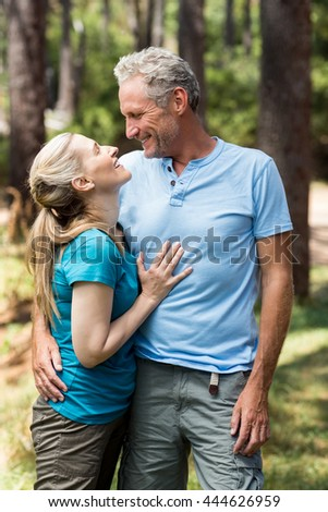 Couple looking and holding each other on the wood