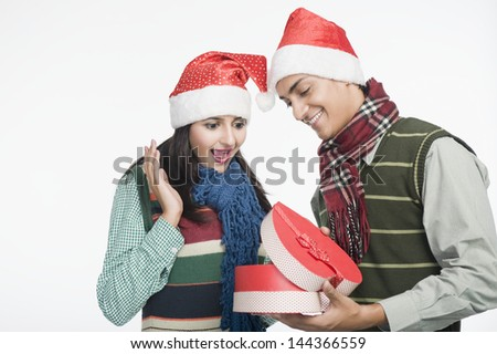 Couple looking at a Christmas present