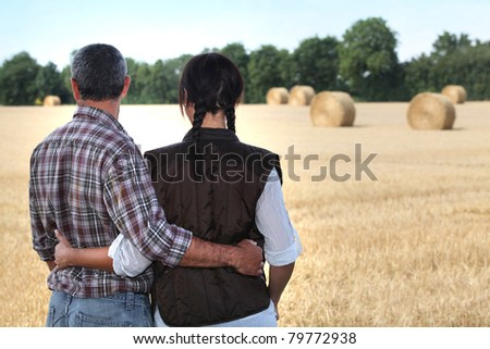 couple looking at a field - stock photo