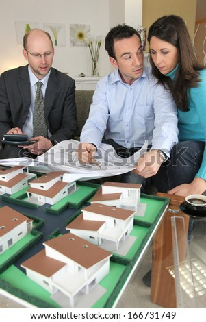 Couple looking at a new build - stock photo