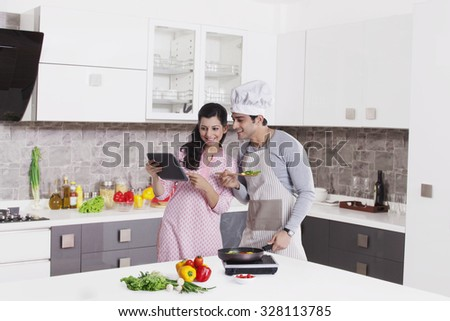 Couple looking at digital tablet - stock photo