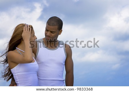 Couple looking at each other - stock photo