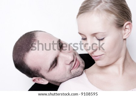 Couple looking at each other - focus on his eyes. - stock photo