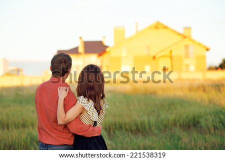 couple looking at home - stock photo
