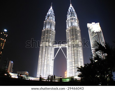 Couple looking at KLCC Twin Towers, located in Malaysia KL - stock photo