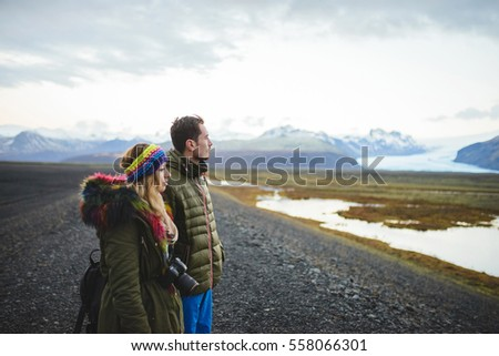 couple looking at lake and mountains in Iceland