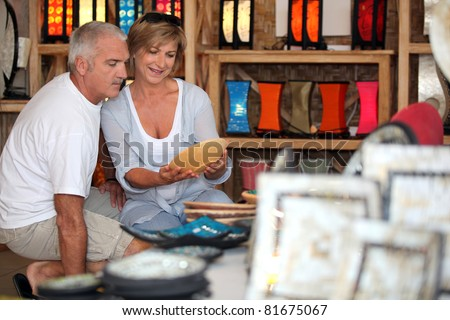 Couple looking at local pottery on holiday