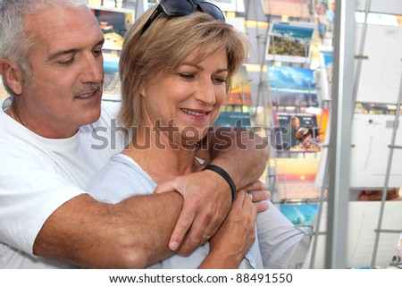Couple looking at postcards - stock photo