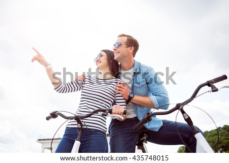 Couple looking at same direction - stock photo