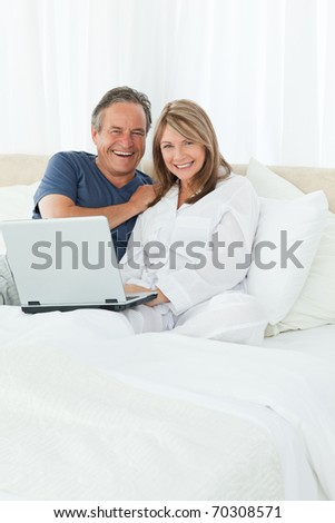 Couple looking at the camera at home