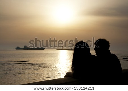 Couple looking at the sea. - stock photo
