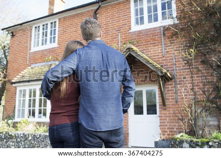Couple looking at their home  - stock photo