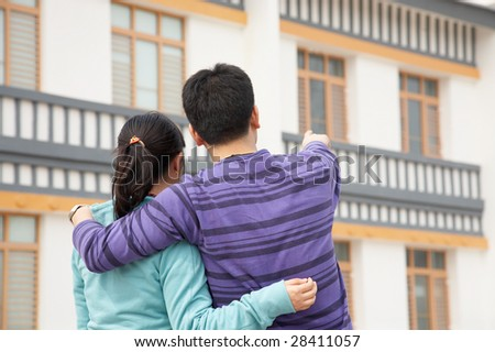 Couple looking at their new house. - stock photo