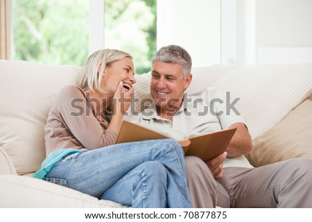 Couple looking at their photo album - stock photo