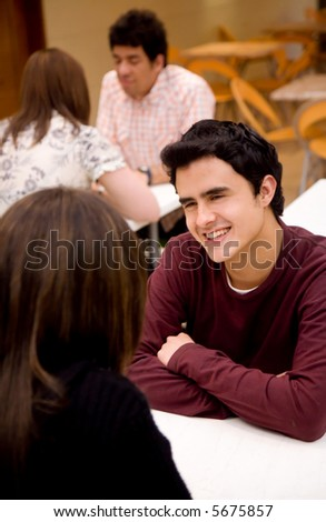 couple looking happy and relaxed talking in a restaurant - stock photo
