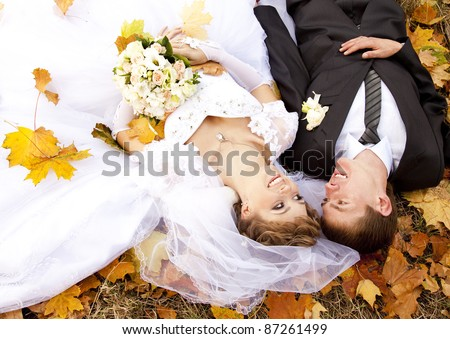 Couple lying down at the park. - stock photo