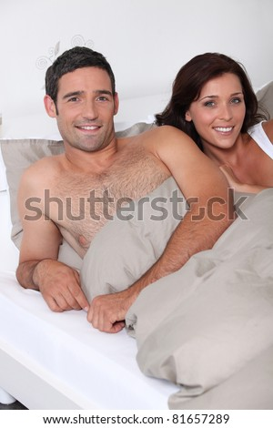 couple lying in bed - stock photo