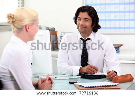 Couple making a date in the diary - stock photo