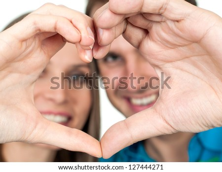 Couple making heart gesture of love - stock photo