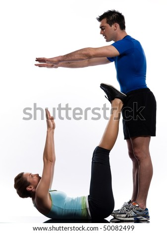 couple, man and woman doing abdominals workout posture on isolated white background - stock photo