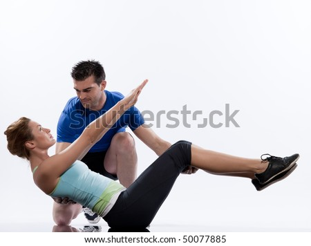 couple, man and woman on Abdominals workout posture on white background. - stock photo