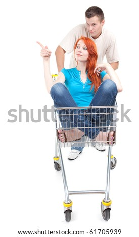 couple - man thrusting shop trolley, woman pointing