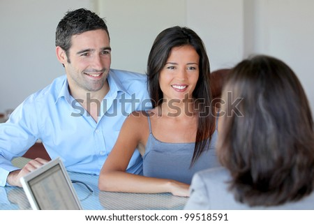 Couple meeting financial adviser for investment - stock photo