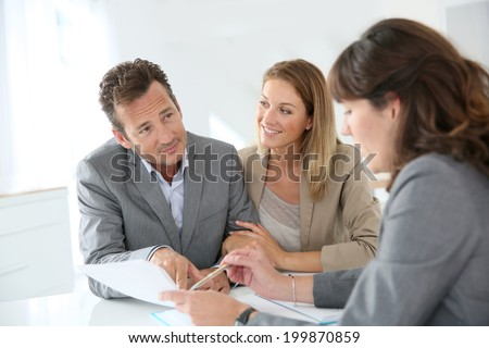 Couple meeting financial adviser for loan granting - stock photo