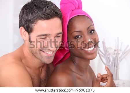 Couple moisturizing - stock photo
