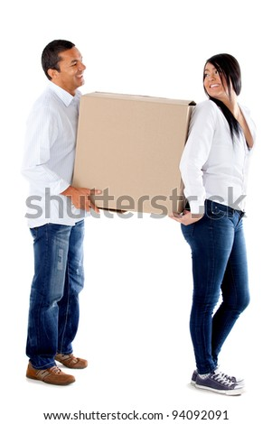 Couple moving house and carrying boxes - isolated over a white background - stock photo