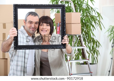 couple moving in new flat - stock photo