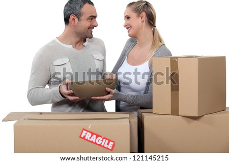 Couple moving in to new home - stock photo