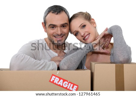 Couple moving into new apartment - stock photo