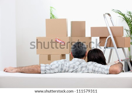 Couple moving into new flat - stock photo