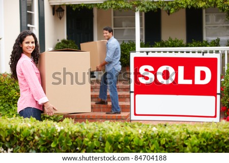 Couple moving into new home - stock photo
