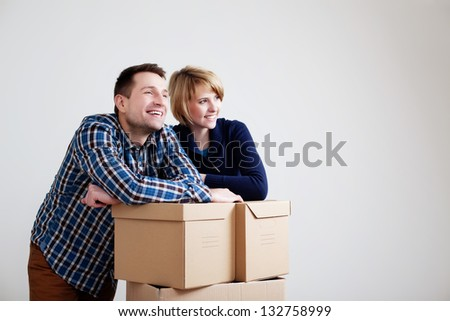 Couple moving to new home - stock photo
