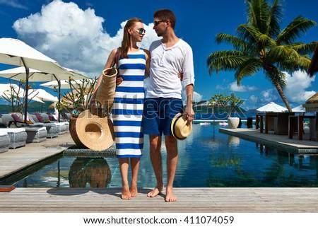 Couple near poolside jetty at Seychelles - stock photo