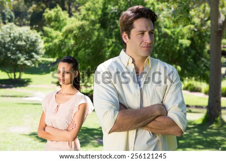 Couple not talking after a dispute in the park on a sunny day - stock photo